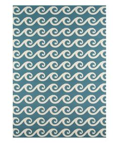 This rug's unique nautical design adds maritime flair to your décor and works as an ideal centerpiece for your space.