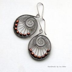Swirl Earrings in Silver with Antique Red Pearls, via Flickr.