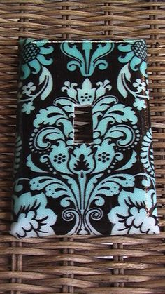 Could do with scrapbook paper, I think. Damask Teal ( Tiffany Blue ) and White on Black Single Toggle Light Switch Plate Cover. via Etsy.