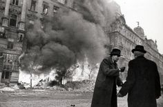 Hungarian civilians stand in the street as Budapest burns. Part of the broader Budapest Offensive, the siege of the city began when Budapest, defended by Axis Hungarian and German troops, was first. Story Of The World, End Of The World, Countries Of The World, World War Two, History Icon, Nasa History, Soviet Army, History Of Photography, Red Army