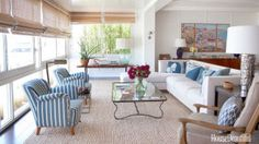 The living room mix: Dunham's contemporary sofa accented with pillows in vintage indigo Japanese textile; a wrought-iron coffee table by Parisian designer Jean Royère; and 1940s Swedish chairs covered in Clarence House's Rigato.