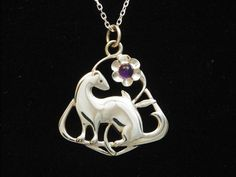 OHHHHH....I want! They have a bunch of ferret jewelry....I may need some!!