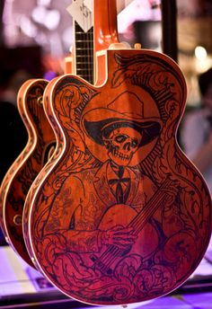 I can only dream of the day I own a guitar worthy of such sick woodburning art...