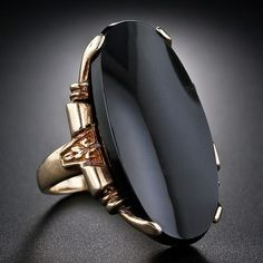 A dramatic, jet-black, 1 inches long oval onyx plaque is tastefully presented in an artfully sculpted Art Deco mounting, adorned with neo-classical design flourishes, crafted in sturdy 10 karat yellow gold. Circa This ring is a size 6 and cannot be sized. Art Deco Ring, Art Deco Jewelry, Jewelry Rings, Jewelry Accessories, Fine Jewelry, Jewelry Design, Antique Jewelry, Vintage Jewelry, Black Onyx Ring