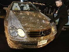 Gold diamond car. The car is fully studded with diamonds.
