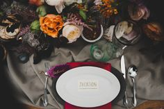 Dinner table place setting with colorful napkin and geode. Photography by Nine Photography. Venue at Stone Crest Venue. Floral by We+You. Dress by a&be Bridal Shop. Jewelry by Primp Salon & Boutique. Rentals by Rent My Dust. Hair & Makeup by Cher Hukill, at Makeup Artistry by Cher. Stationery by Brittany Gilbert Design. Calligraphy by The Left Handed Calligrapher. Desserts by Tart Bakery Dallas. Modeling by Shanelle Paine.