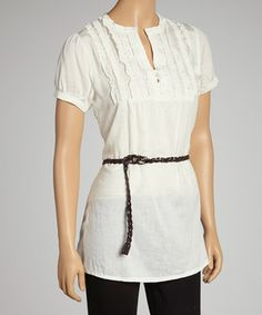 A textured placket combines with a soft and lightweight feel, while a braided rope cinches the waist to flatter and feminize the figure.