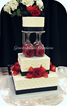 Elegant White, Black and Red Wedding Cake by Graceful Cake Creations, via Flickr  That's a unique cake style.