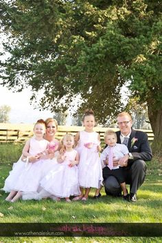 bride and groom with flower girls and ring bearer