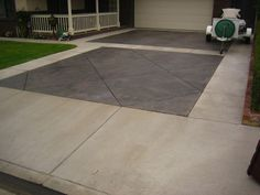 Colored Concrete Can Make Even A Simple Driveway Inviting This Dual Toned