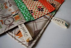Erle perle's zakka potholders. Love the little tags--not brand labels, but an embellishment