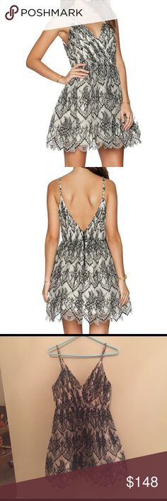 Alice + Olivia Cara Embroidered Lace dress Exuding youthful, ladylike charm this full-skirted babydoll dress is overlaid in gossamer two-tone, ivory and black, lace and designed with plunging front and back V-necklines. Adjustable straps with exposed back zipper, hook and eye closure. Lined. Size 2, runs true to size. Worn once, no signs of wear. Alice + Olivia Dresses Mini