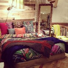 Bohemian Bedroom Inspiration love the stained glass, patchwork wall hanging, and fabric