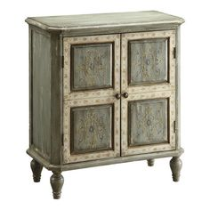 Warmly weathered chest with a hand-painted medallion scroll motif.    Product: Accent chestConstruction Material: Wood...