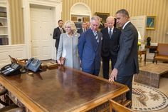 President Barack Obama and Vice President Joe Biden show the Resolute Desk to Charles, Prince of Wales and Camilla, Duchess of Cornwall, prior to a meeting in the Oval Office, March 19, 2015. (Official White House Photo by Pete Souza)
