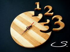 Solid Wooden Modern Wall Clock with numbers.  This will look great hanging on your family room or possibly office wall.  Great gift for person who has everytthing.  It is 100 % handmade in our wood shop.    Includes:    - approximately dimensions: 22 cm. in diameter (8,6 in.)  - finished in 2 coats of organic natural wax  - silent motor  - requires one AA battery  - black minute and hour hands,red second hand  - packaged in the sturdy box for safe shipping        In our shop, you will find…