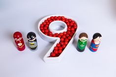 """Candy placed in a """"9"""" dish + peg dolls from a Modern Justice League Birthday Party via Kara's Party Ideas KarasPartyIdeas.com (36)"""