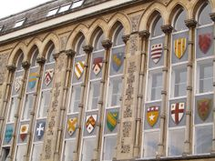 UK - Hampshire - Winchester - Coats of arms shields on windows |