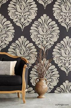 This large scale black damask mural has an oriental pattern running throughout the design. Hues of gold create a regal feel. Comes in 2 panels that measures 3.05-ft wide by 9.2-ft tall when assembled.