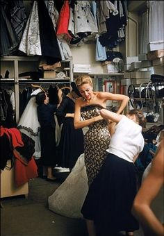 Backstage at the Pierre Balmain couture show, Paris 1954. Photo by Mark Shaw.