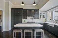 Gorgeous kitchen with dark cabinets and brass hardware