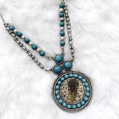 Silver & Turquoise Boho Style Medallion Necklace Brand new, silver and turquoise necklace & earring set. Not real silver! Please ask if you have any questions. Bundle and Save Core Jewelry Necklaces