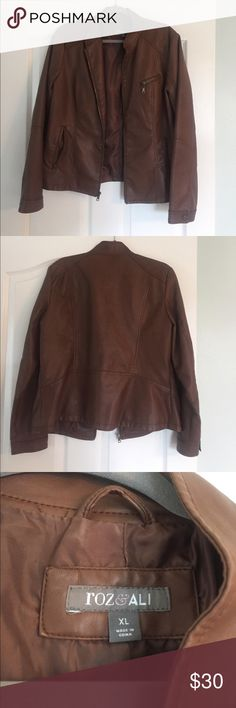 Brown faux leather jacket Medium brown faux leather jacket with quilted shoulders. Very soft leather-feel and very warm. Perfect condition- worn twice. Fits anyone large- x large. All offers welcome! Roz & Ali Jackets & Coats