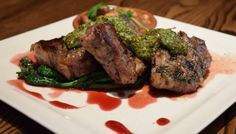 Lamb Porterhouse with Italian sausage and white bean ragoût, broccoli rabe, citrus-cilantro almond pesto and pomegranate glaze | Green Valley Grill | Greensboro, NC