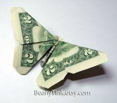Butterfly dollar origami - http://www.ikuzoorigami.com/butterfly-dollar-origami/ More