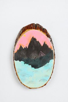 Urban Outfitters wall art.  Grab a slice of wood and paint directly on it.