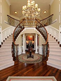 Looking for Other Space and Foyer ideas? Browse Other Space and Foyer images for decor, layout, furniture, and storage inspiration from HGTV. Double Staircase, Iron Staircase, Staircase Design, Foyer Staircase, Basement Stairway, Wood Stairs, Wooden Staircases, Stairways, Stairway Lighting