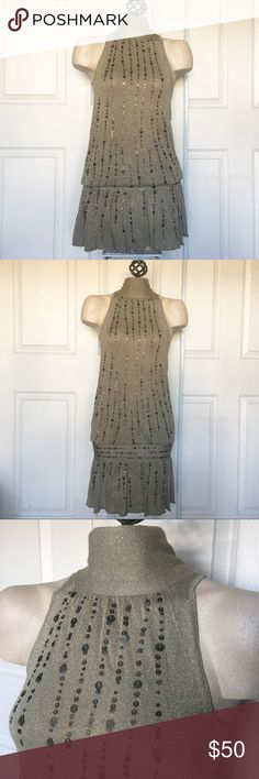 Sequin Dress! Beautiful Sequin and sparkle mini dress by Mango! A flattering olive green shade with sparkle in the material. This would be great for New Years! Sexy Open back. Has a little bit of stretch. US size XS. Excellent, like new condition. NO TRADES Mango Dresses Mini
