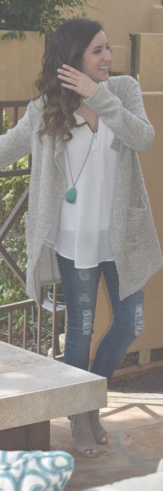 Comfy Grey Wrapped Sweater over a White Lush Top with Ripped Denim paired with Peeped Toe Nude Bootie