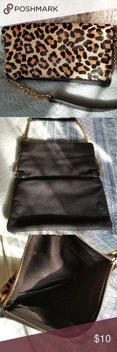 Cheetah Print/ Black Clutch Cheetah Print and black clutch with detachable gold chain strap. Foldover style. Magnetic inner closures to keep bag's slim profile. Perfect evening bag. Measures 11 × 6. Strap: 30 inches Express Bags Clutches & Wristlets