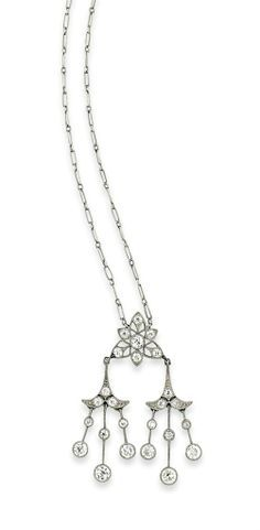AN EARLY 20TH CENTURY DIAMOND PENDANT NECKLACE, BY TIFFANY & CO. The fine link necklace to a millegrain-set brilliant-cut diamond openwork star motif pendant suspending a further two diamond tassel drops, circa 1915