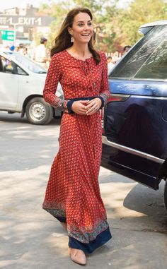 Kate Middleton, India. On the third day of the tour, she donned a breezy printed maxi dress designed by Glamorous and a pair of nude flats while visiting a center for homeless children in New Delhi run by the charity Salaam Baalak.