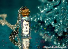 LET IT GO Disney's Frozen Magical Flakes and a Snowflake Charm Necklace, Oscar Winner, by Life is the Bubbles on Etsy, $16.00