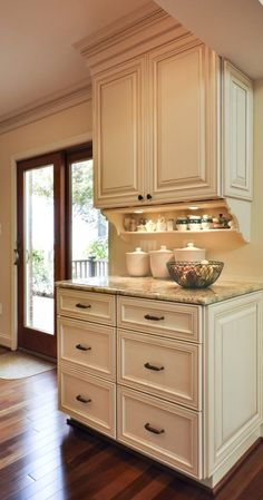 Baking Center.  I like the spice shelf with lighting and the marble countertop for rolling out pie crusts