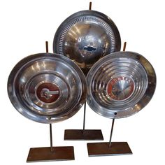 Trio of Antique Hubcap Sculptures | From a unique collection of antique and modern sculptures at https://www.1stdibs.com/furniture/decorative-objects/sculptures/