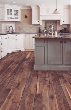 Love this color wood floors and cabinet color combinations