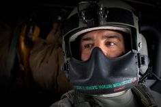"U.S. medic Robert Amrani with the U.S. Army's Task Force Mustang ""Dust Off"" Company based out of Fort Hood, Texas, wears a mask around his helmet bearing the words, ""When I have your wounded"", during a mission in his Blackhawk medevac helicopter in Kunduz, north of Kabul, Afghanistan, Monday, Feb. 21, 2011."
