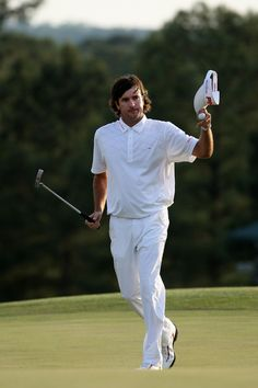Bubba Watson of the United States gestures after putting for par on the 18th hole during the final round of the 2012 Masters Tournament at Augusta National Golf Club on April 8, 2012 in Augusta, Georgia.