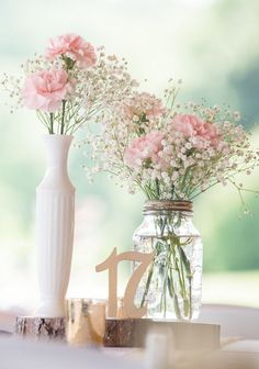Rustic Romantic Outdoor Wedding - pink centerpieces with babys breath and roses