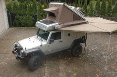 Mike Hiscox's custom Earthroamer XV-JP build from Expedition Portal. Built by Earthroamer on a Jeep Wrangler, Mike had it customized by custom surfboard/auto builder Paul Jensen.