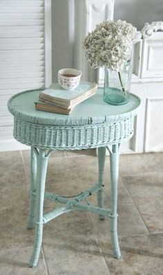 Wicker side table gets new life with a coat of light turquoise paint…