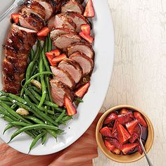 Pork Tenderloins with Balsamic Strawberries | Wrap the pork tightly with bacon to give it smoky flavor and a crispy crust.