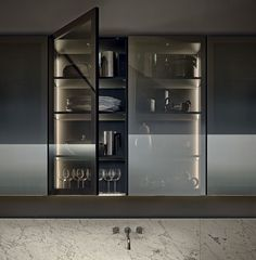 Varenna_Wall unit PR19 with bronzed aluminium frame and bronzed reflecting glass door with multi-led inner lighting.
