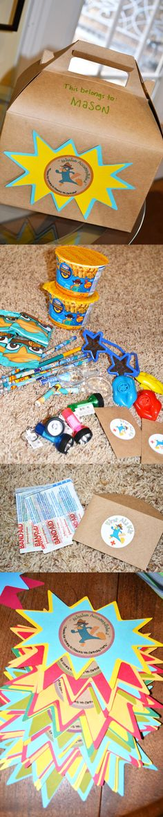 Inside the gable box party favor: Phineas and Ferb mac n cheese, pencils, magnifying glass, band aids, mini flashlights, lips whistle blower, superstar sunglasses, perry fruit snacks.