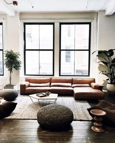 Industrial-style living room with metal framed windows