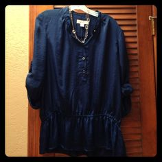 Navy Michael Kors blouse Sleeves fasten up to be a 3/4 length. Hard to tell in pics but is a true navy color. Waist elasticized to flare at the bottom. Buttons are silver and navy. Smoke free home. MICHAEL Michael Kors Tops Blouses